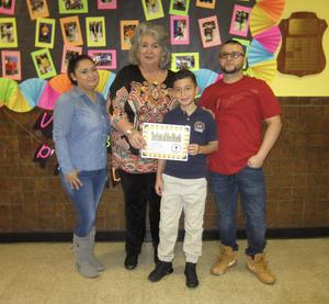 hanser R. his family and Principal Tierri receiving STudent of the month of nov. certificate