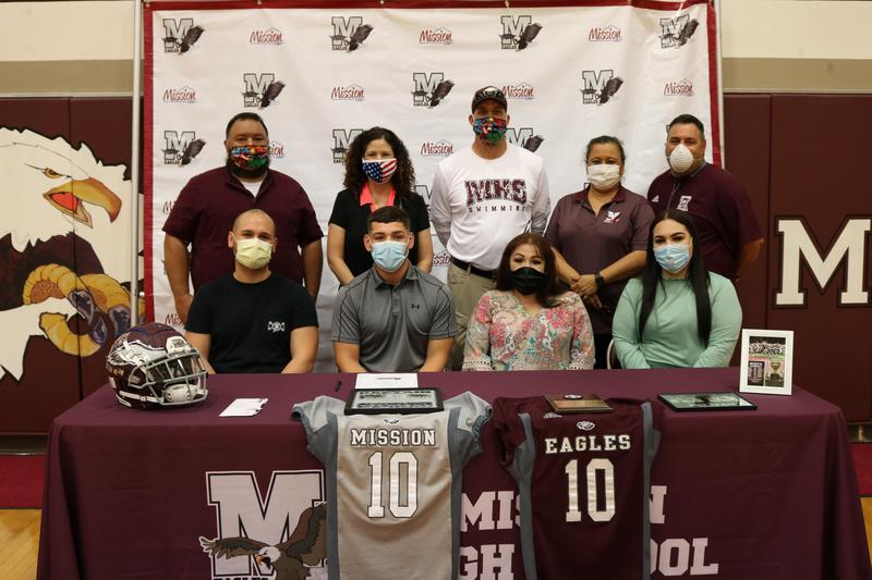 MHS football player, Fabian Ahumada, signs letter of intent.