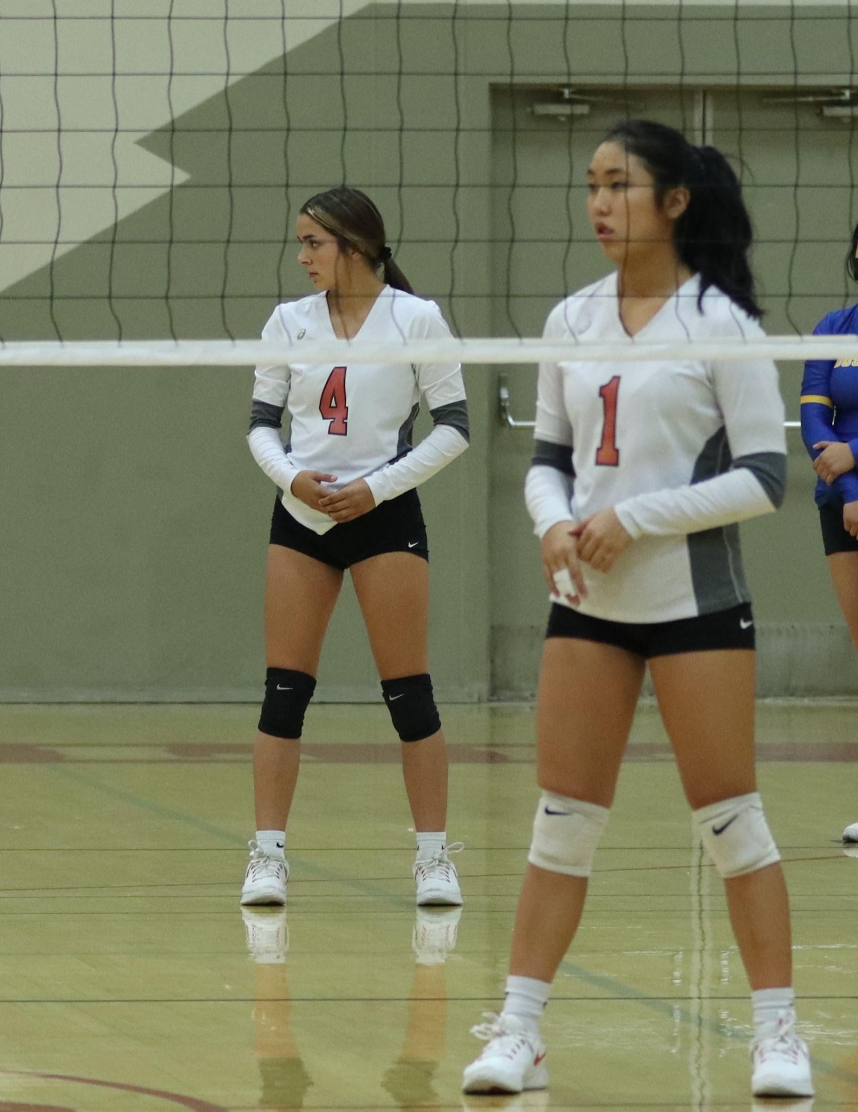 Varsity girls playing volleyball against Firebaugh