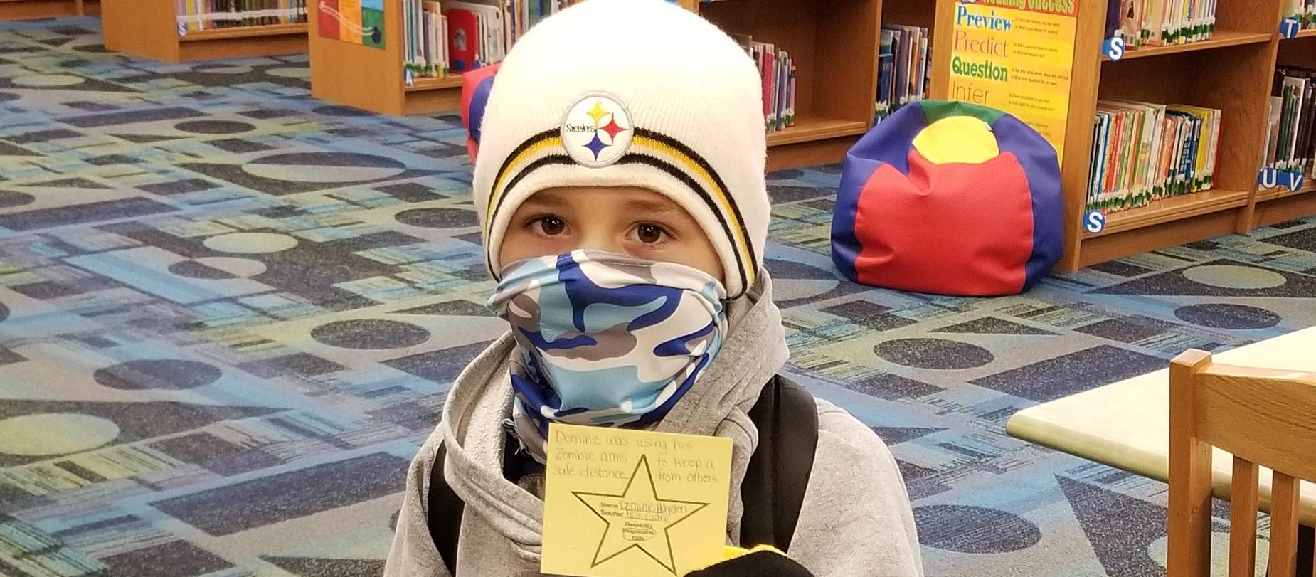 boy wearing Steeler gear posing for camera
