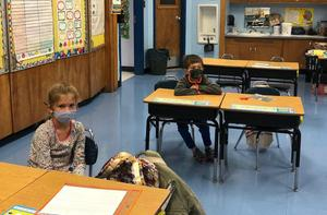 Photo of Wilson students at desk wearing masks at desks.