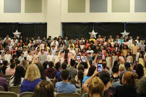the choir singing in front of their parents, family, & friends