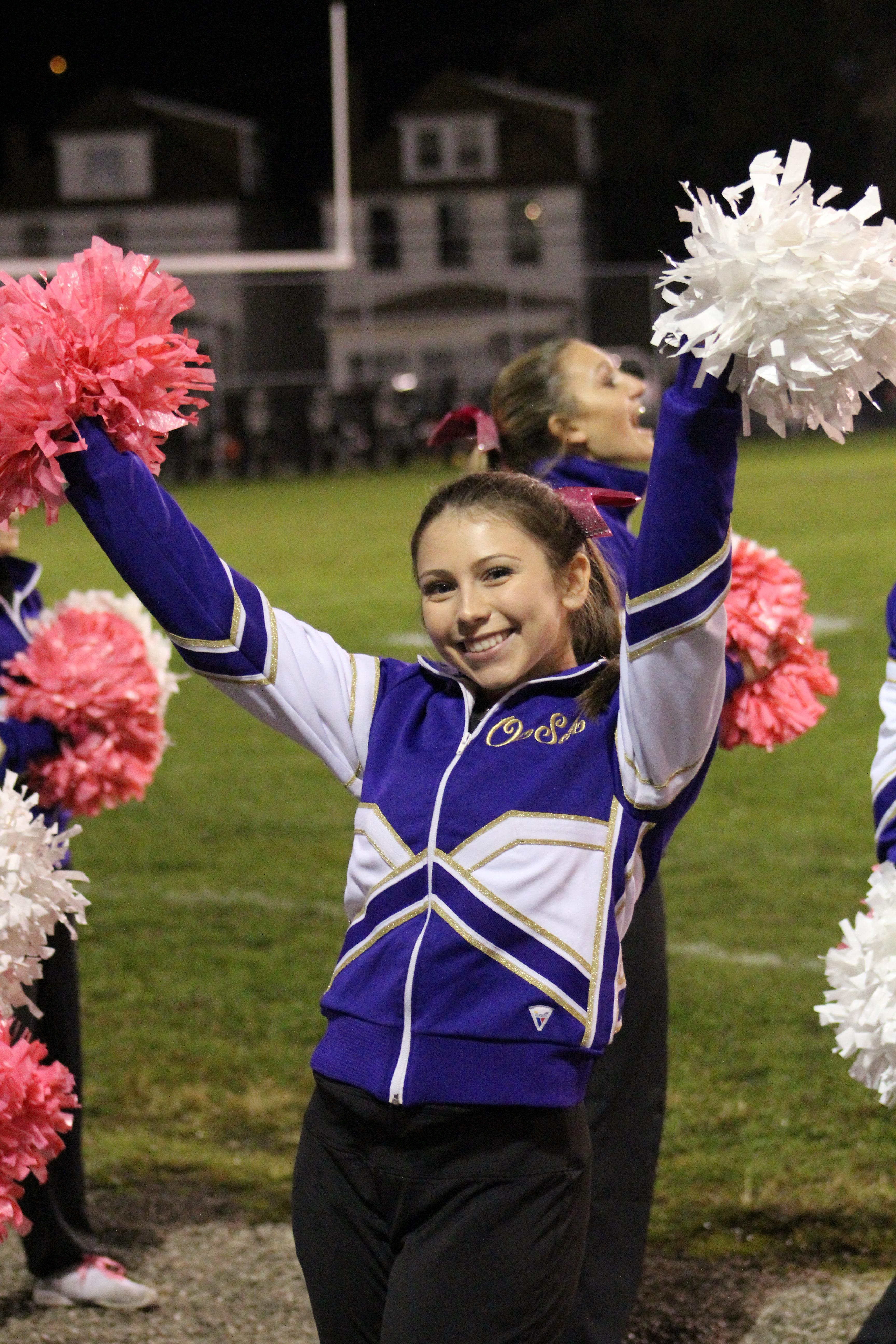 Alex leads the crowd in a cheer at a football game