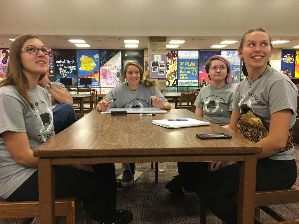 Students sitting at a table in a library