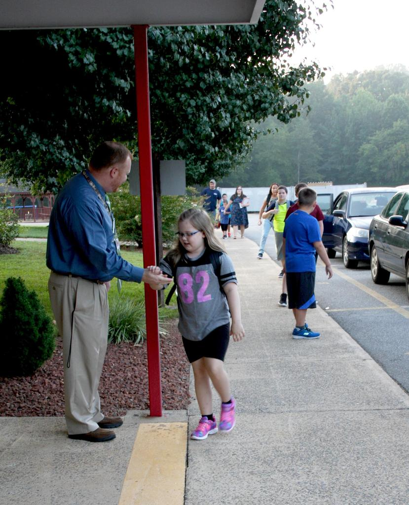 Principal welcomes new students back to school at C.B. Eller Elementary.