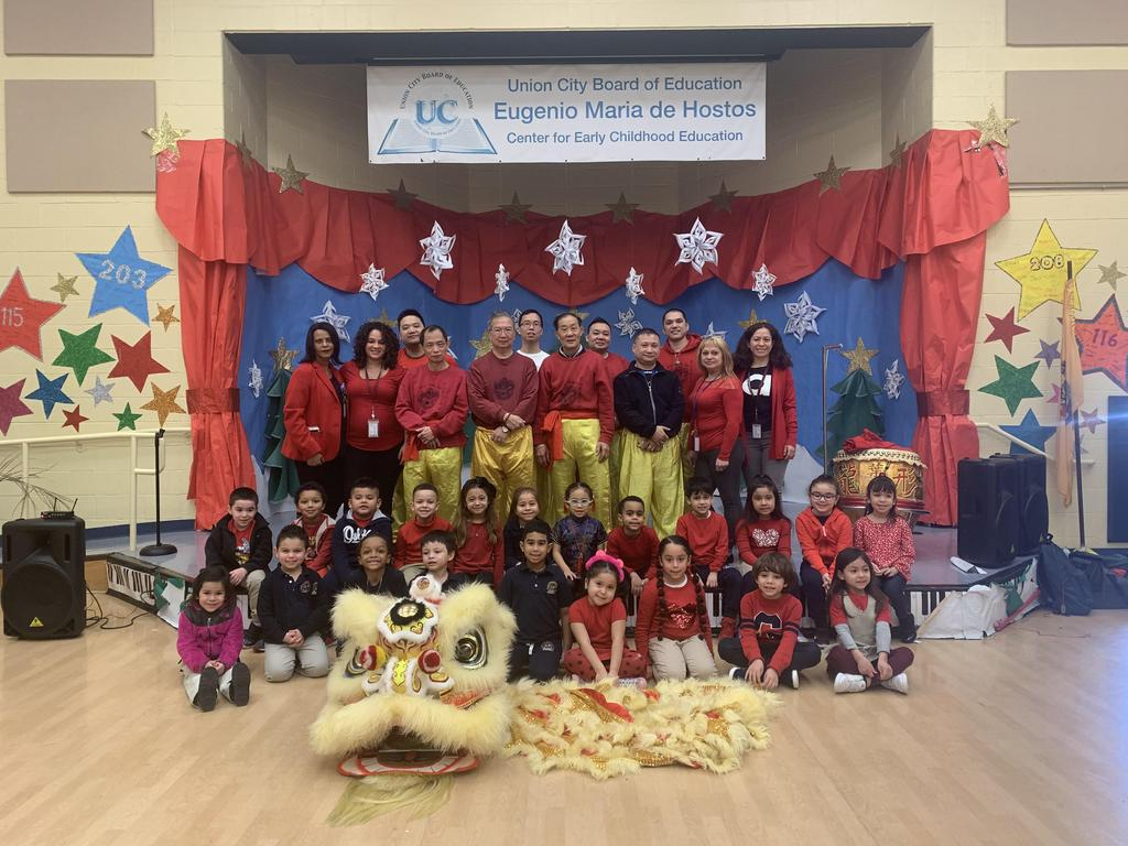 Chinese performers on stage with the kindergarten class