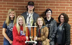 Jasmine Augustine, Kassidee Clayton, Ty Davis, Artemis Jensen and Abigail McClinn pose with their advisor and trophy.