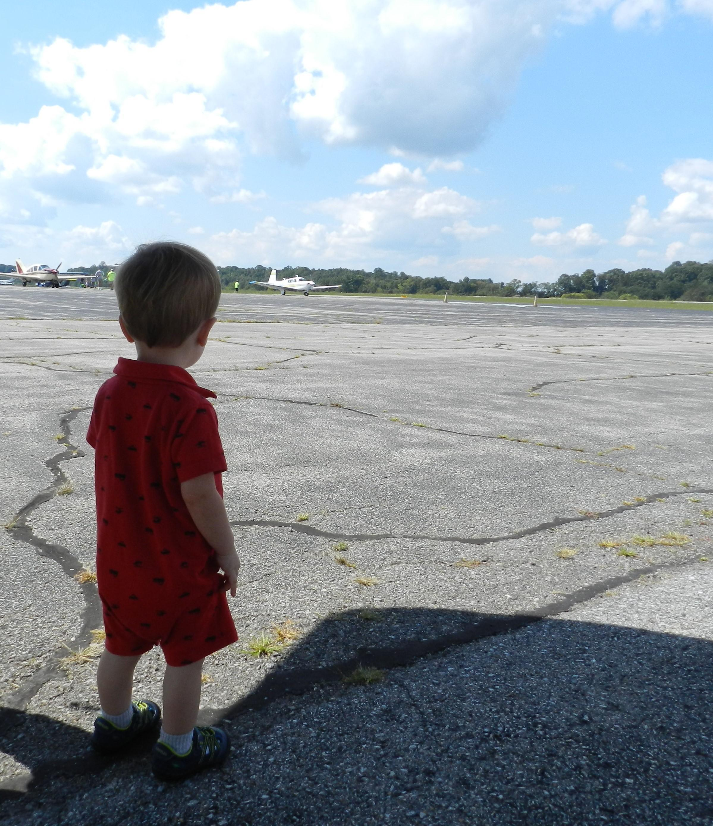 Little boy looking at plane