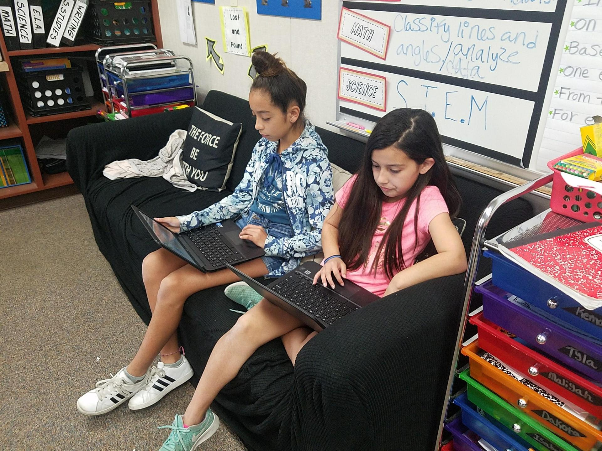 students using soft seating with their chromebooks