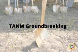 A picture of a shovel in dirt with a line of shovels in the background. The text reads