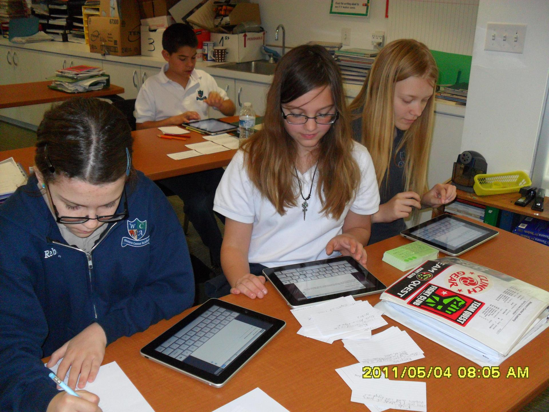 Students in lab class working on iPads