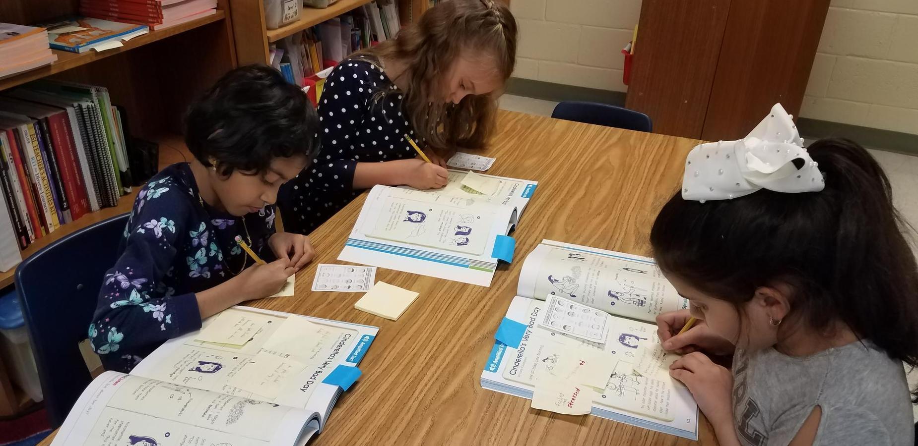 ESL Students Working
