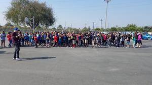 Photo of students gathered outside for an aerial drone photo with Josh Drean
