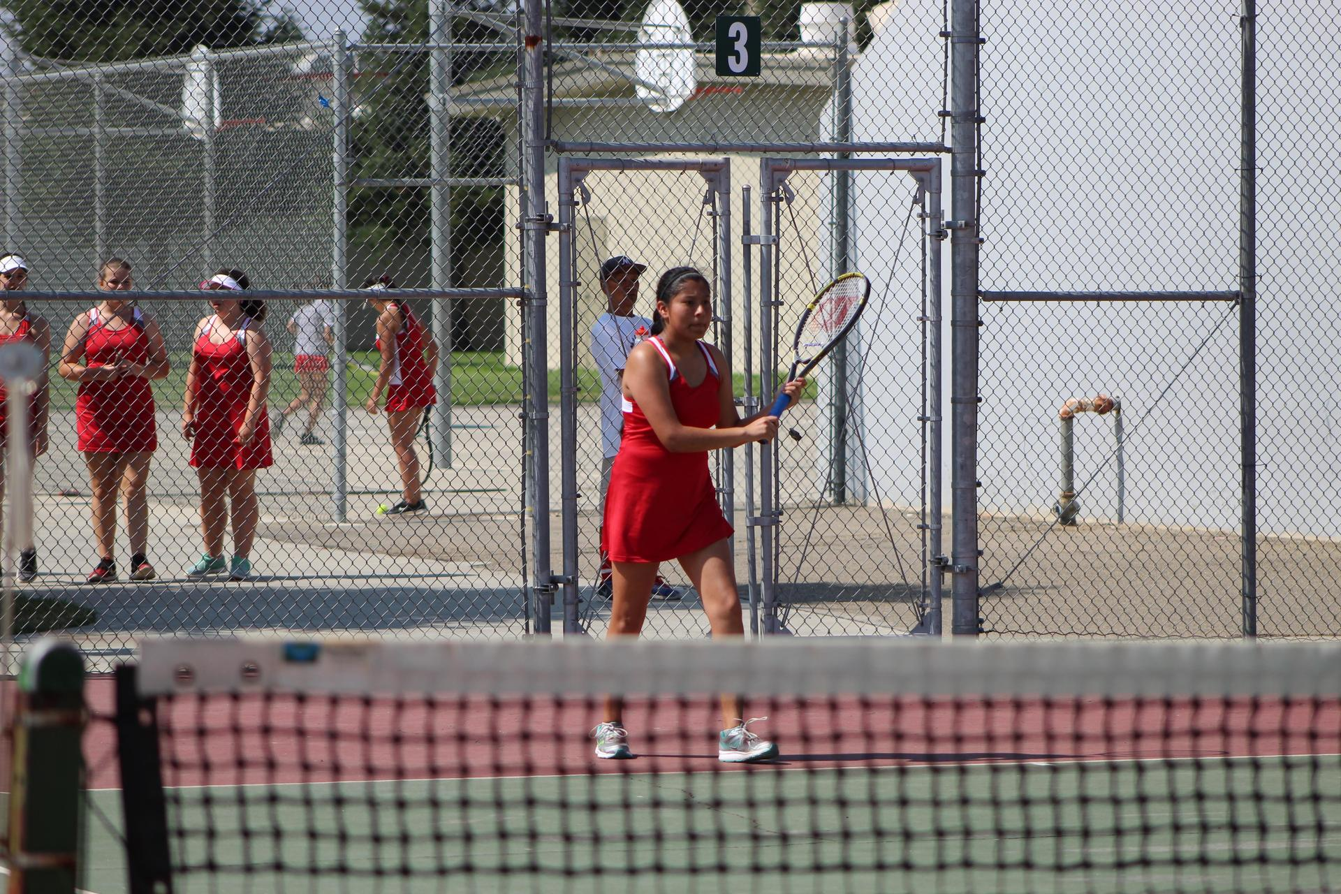 Girls playing tennis vs McLane