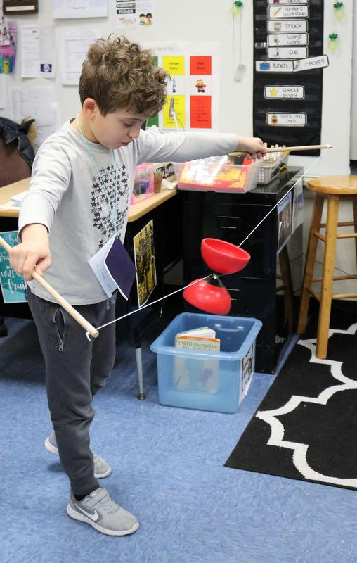 """Photo of Franklin 2nd grader enjoying traditional Chinese games during """"China Day"""" on Feb. 21, one of many activities that offered the students the chance to learn about Chinese language, history, and culture."""