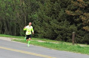 Page Principal Mr. Bruno runs past the middle school on  his way to Page.