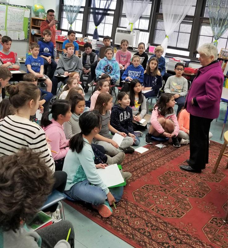 Photo of:  Holocaust survivor Sally Frishberg brings a message of hope and strength to 5th graders at McKinley School on March 21. Born in Poland in 1934, Frishberg shared her experiences as a young child whose family was forced to flee their home in Poland when the Nazis invaded their village.  She and her family were taken in by a Polish farmer and hidden in his attic for two years.