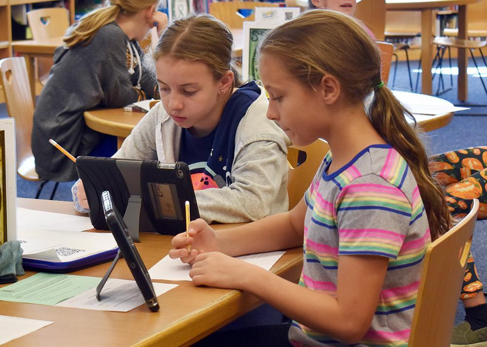 students researching information in the library