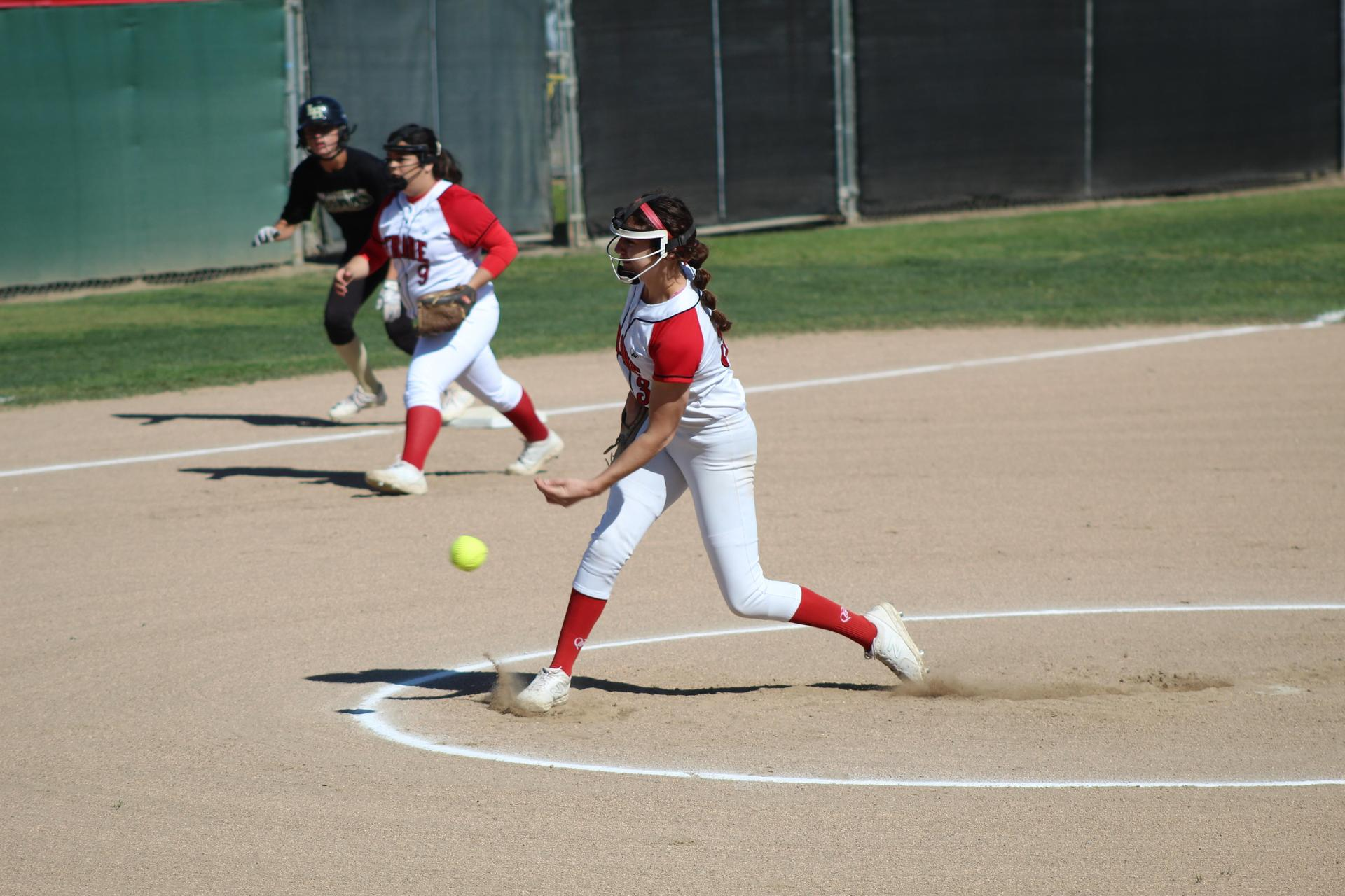 Girls playing softball against Liberty