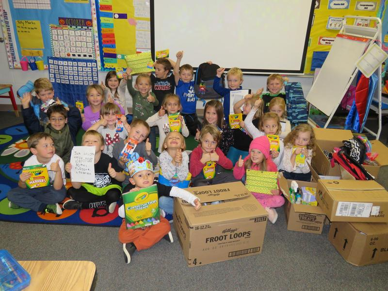 Mr. Bultema's kindergarten class shows off all the supplies Joey collected at his birthday party.