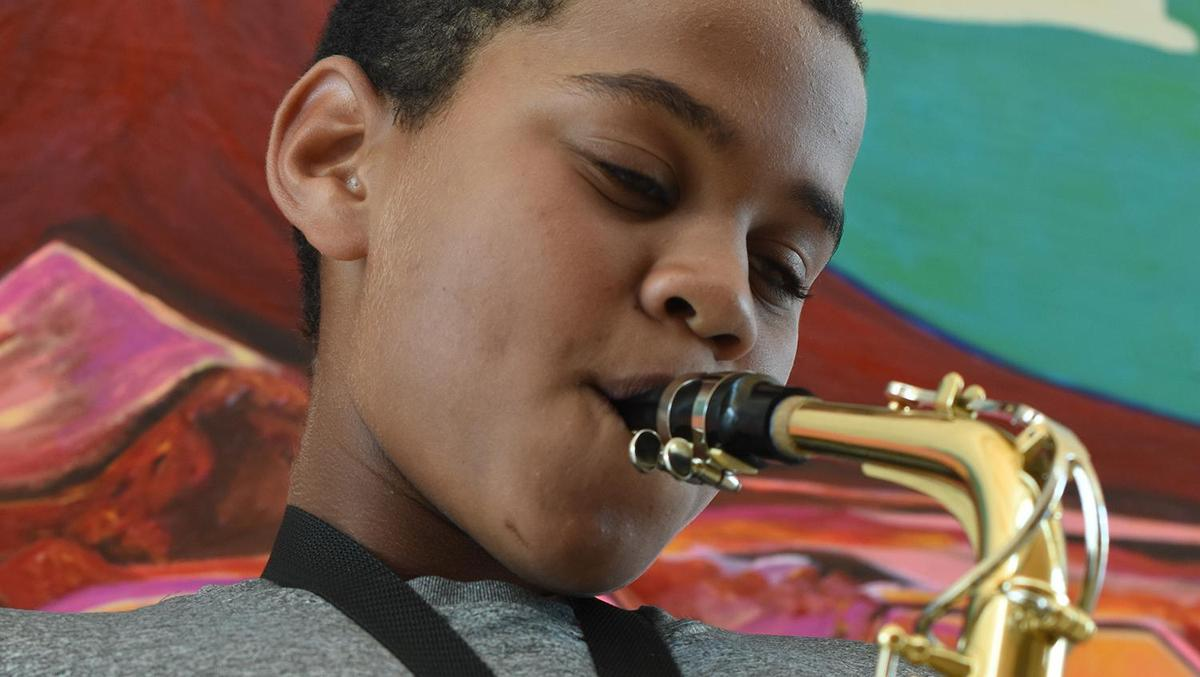 Middle School Student Playing Saxophone