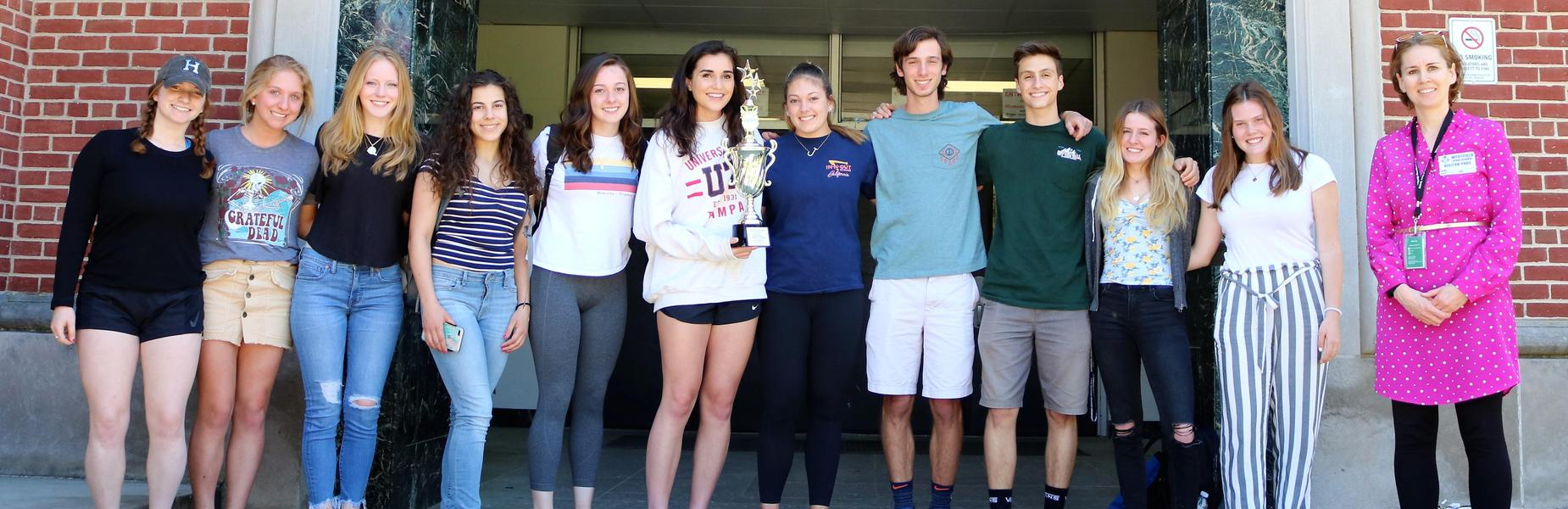 Photo of WHS students receiving trophy from Community Food Bank of NJ for collecting most amount of food during fall