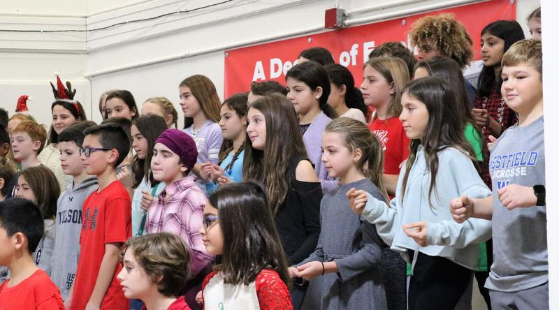 Photo of Wilson 5th graders performing holiday concert for preschoolers and kindergartners at Lincoln.