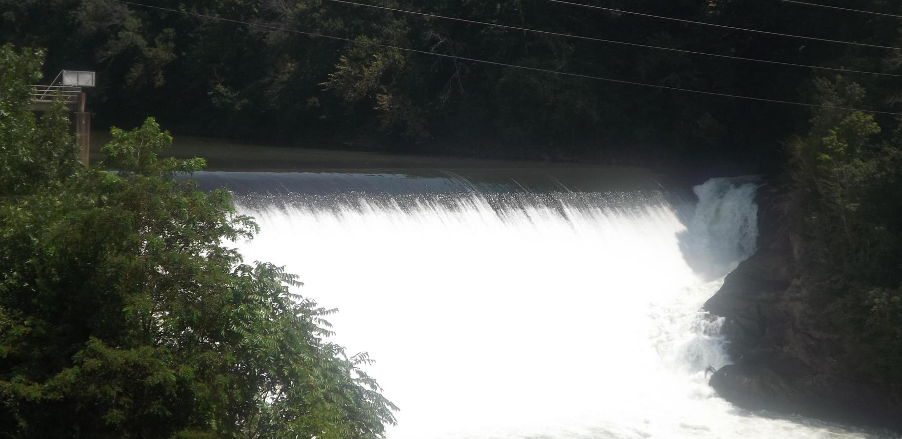 Picture of water flowing over a hydro plant.