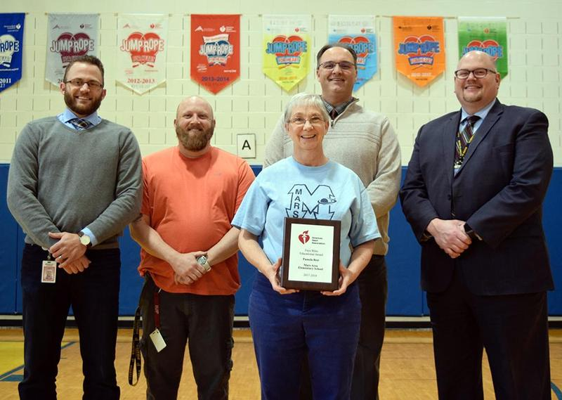 Pam Best, retired Mars Area Elementary School health & physical education teacher (center), is presented with the 2019 Faye Biles Education Award by Brad Cavanagh, American Heart Association youth market director. Also pictured are Brian Fox, health & physical education teacher; Todd Lape, principal; and Dr. Wesley Shipley, superintendent.