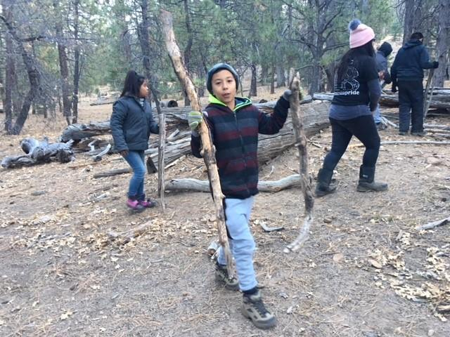 Campers building shelters
