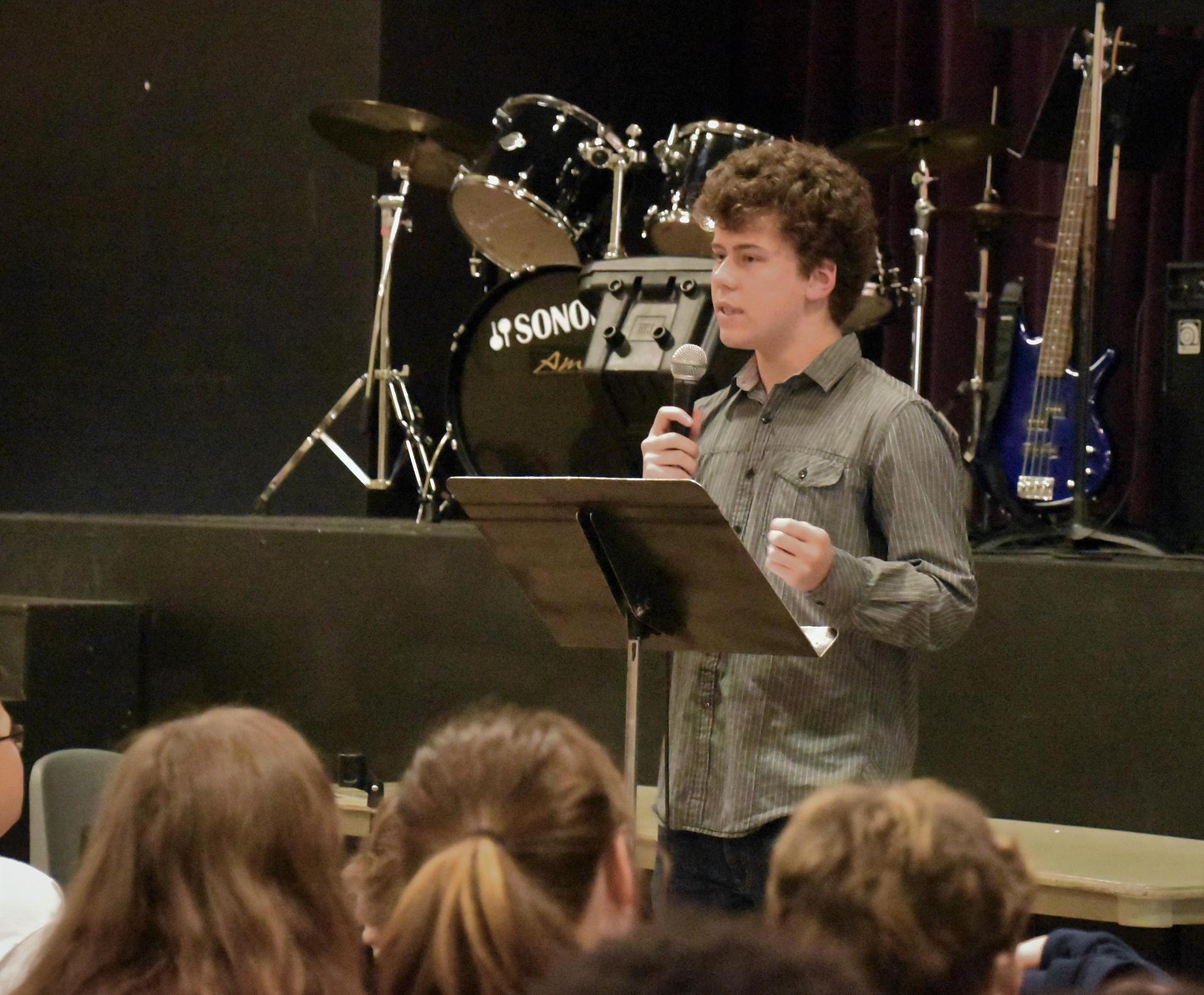 Alum Johnny Humphrey '18 speaking at chapel