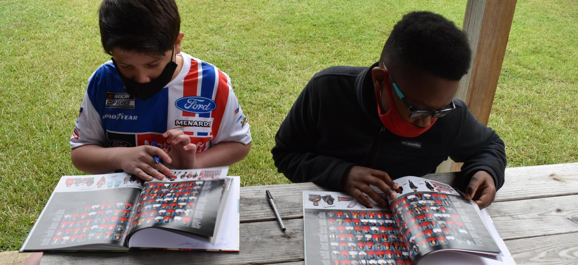 Students participating in Yearbook Signing Party.