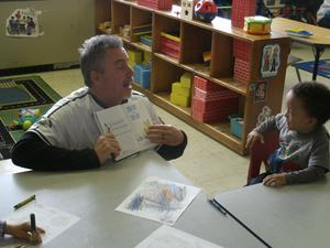 Hi-Tom coach works with students.