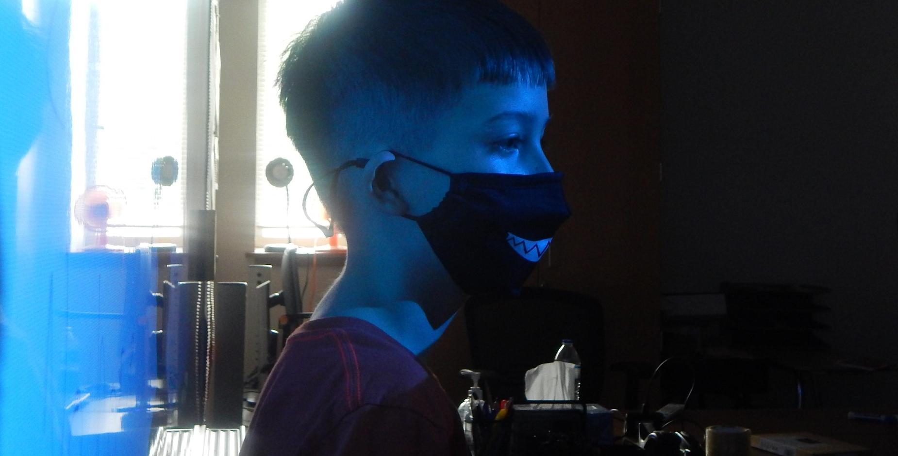 Child inside with mask