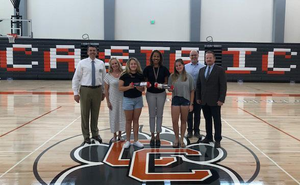 Cambria and Maci Lawrence presenting a Keep the Pressure Kit to Castaic High School and William S. Hart UHSD Leadership