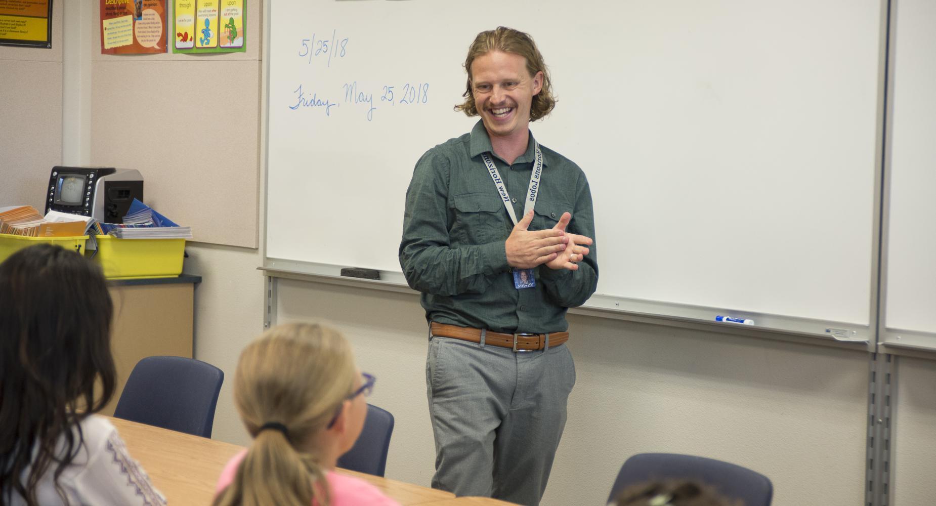Teacher laughs at head of class