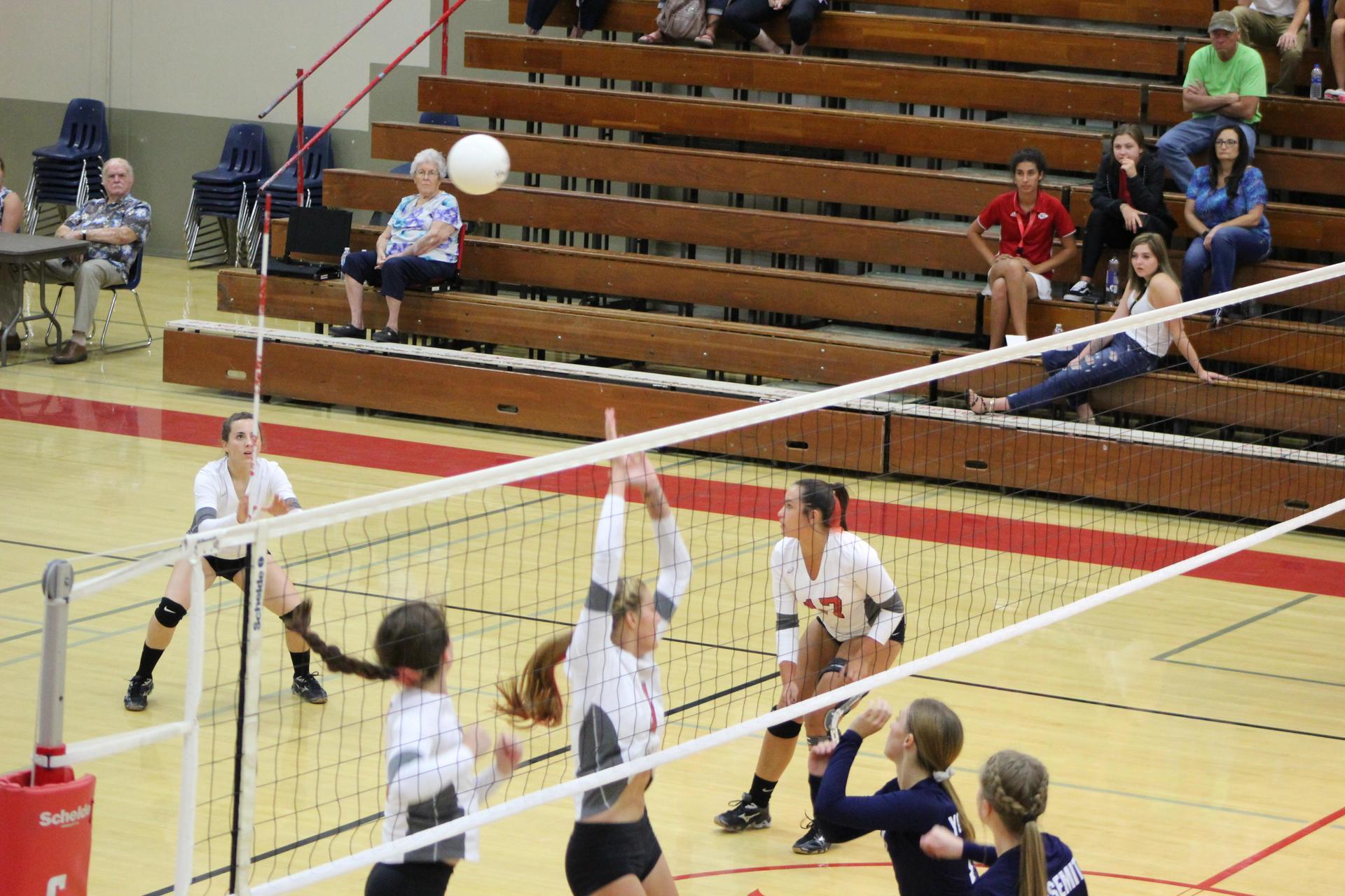 Girls playing volleyball against Yosemite
