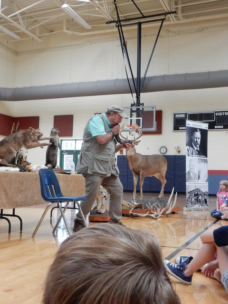 Ward Burton Wildlife Representative demonstrating to students