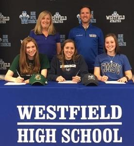 Westfield High School Track and Field Coaches Jennifer Buccino and Joseph Berardi join track and field student-athletes as they sign Letters of Intent to continue competing at the college level.  From left, Lauren Triarsi – University of Vermont, Leah Norton – Lebanon Valley College, and Megan Neiswenter – College of Mount Saint Vincent