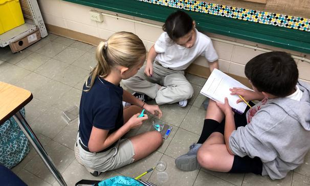 5th graders testing properties of matter