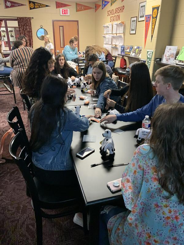 Students work on assembling items for deployed service members