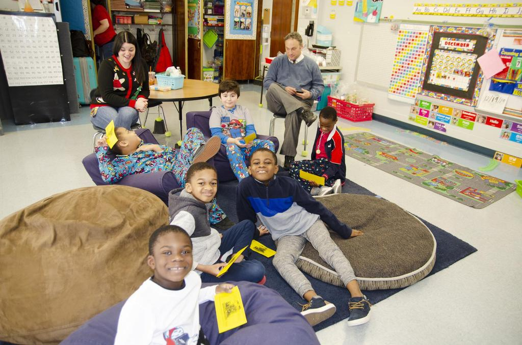 Students gather for the reading inside a classroom