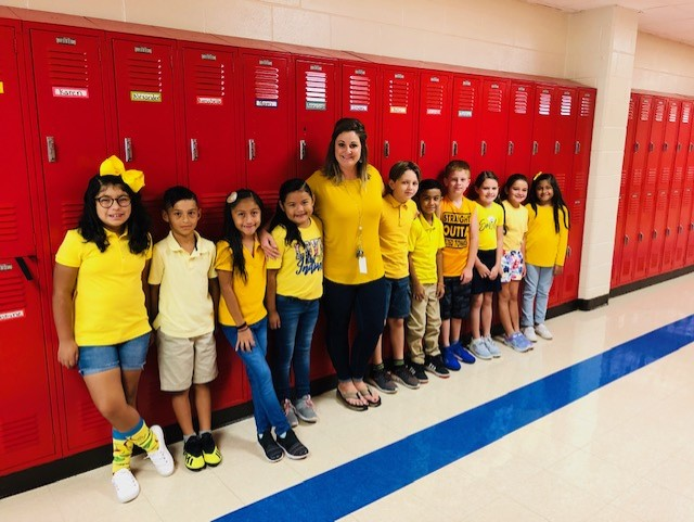3rd Grade teacher with her students during All Out Yellow Day