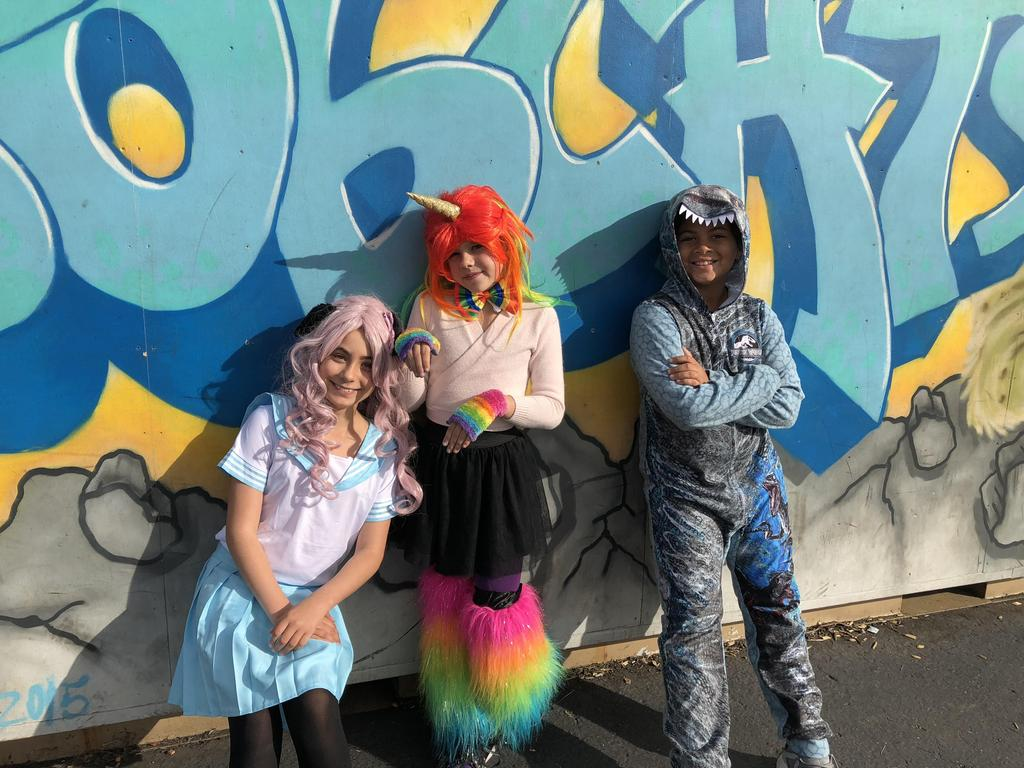 3 students in costume