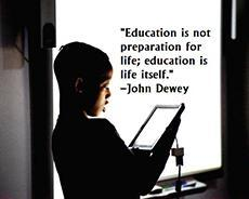 """Education is not preparation for life; education is life itself."" -John Dewey Image of student standing in front of a SmartBoard doing a presentation from his iPad"