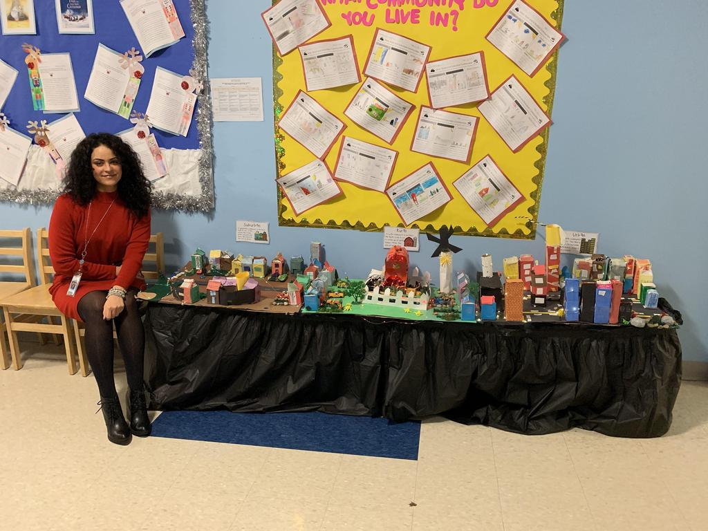 Ms. Hernandez with her class' city diorama