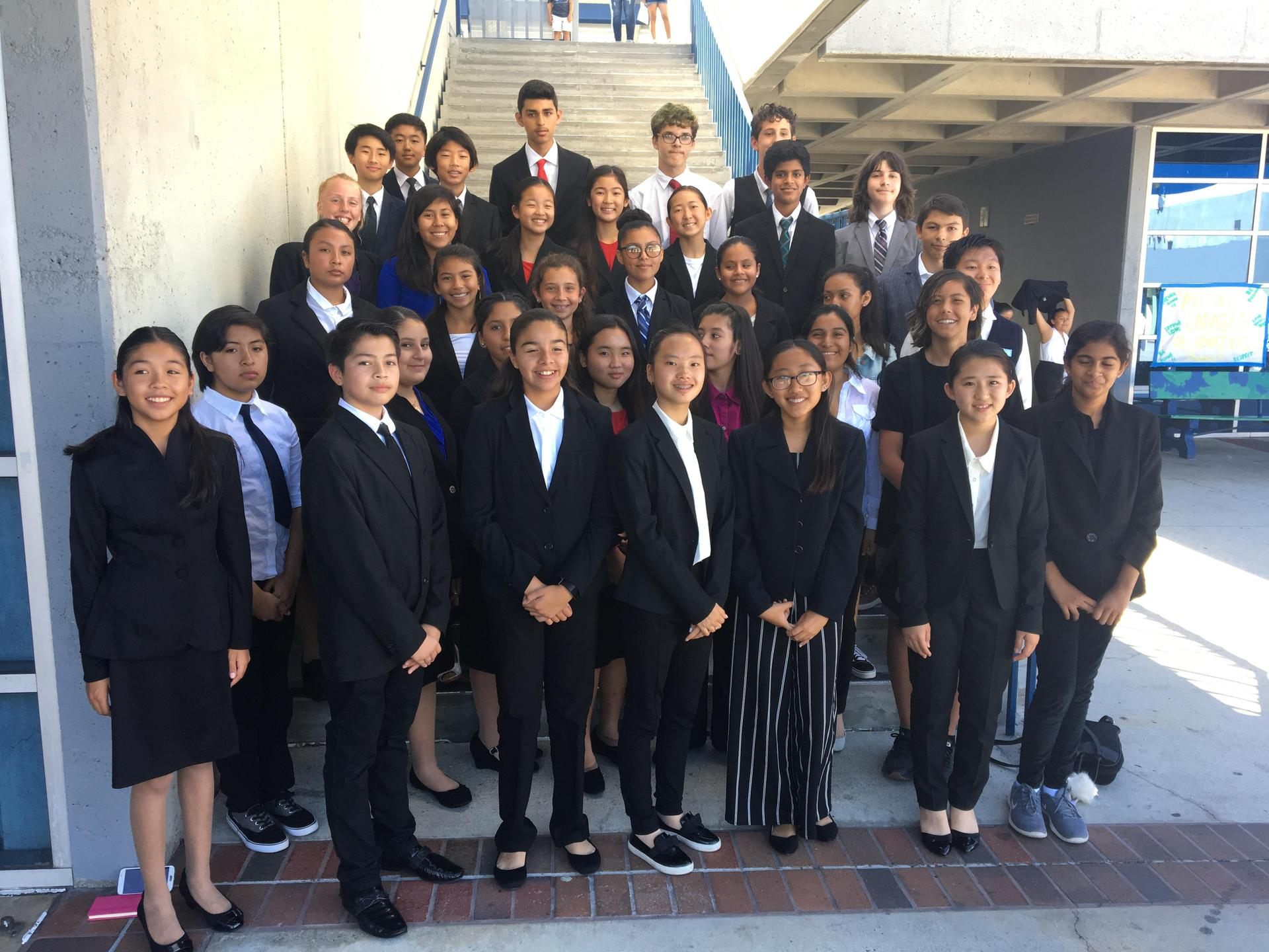 Large group of students in suits