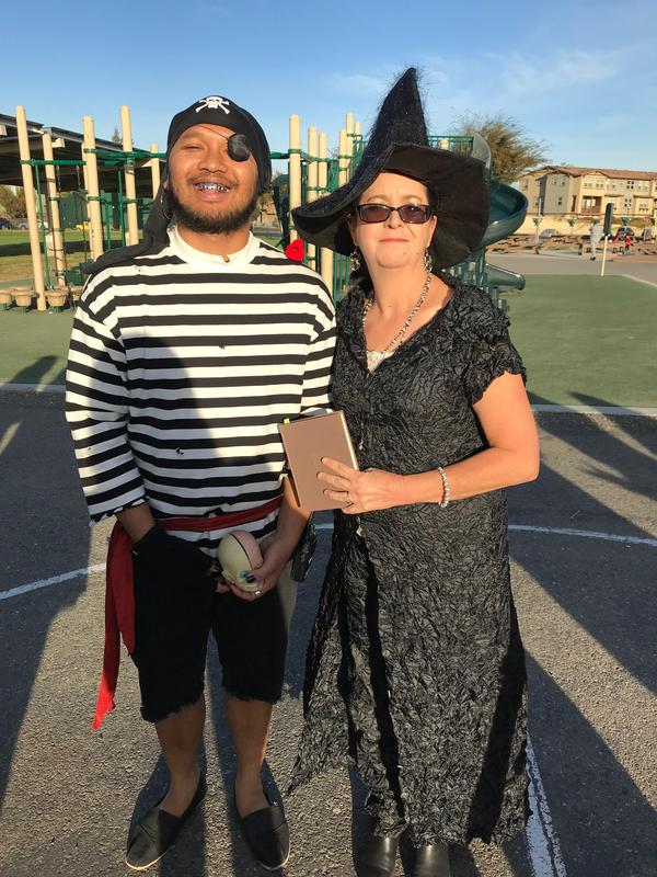two staff dressed up as a witch and a pirate