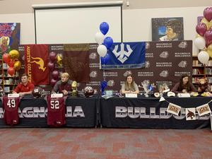 Four students from Magnolia High School signed National Letters of Intent on Wednesday, Feb. 5