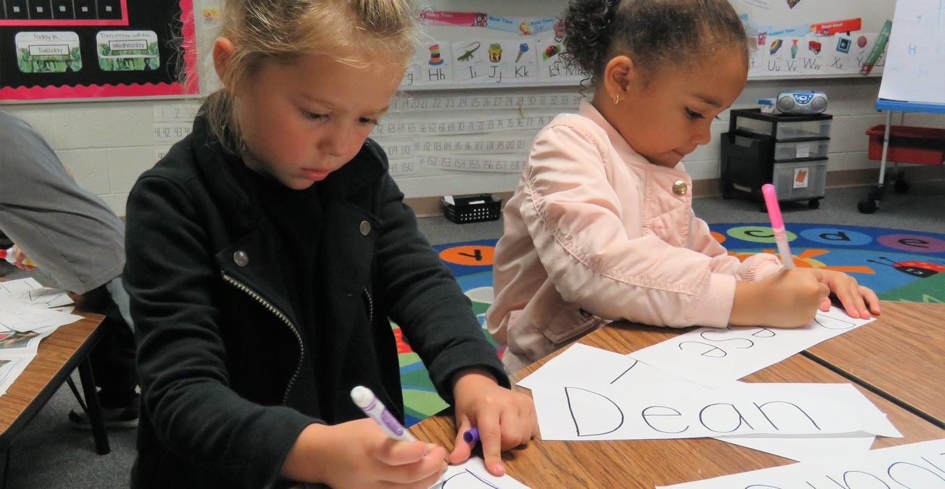 Young 5 students learn to write their names.